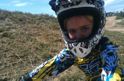Kid wearing motorcross helment