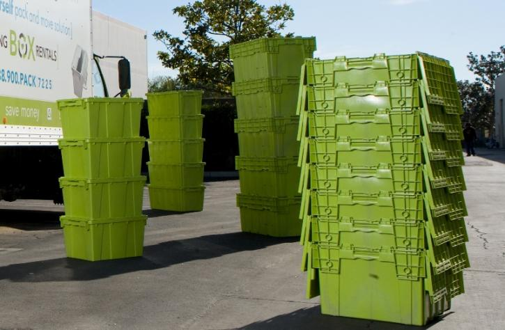 green plastic moving boxes