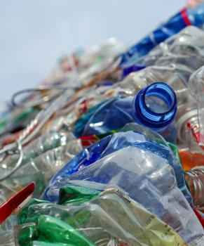 Colorful plastic bottles crushed for recycling