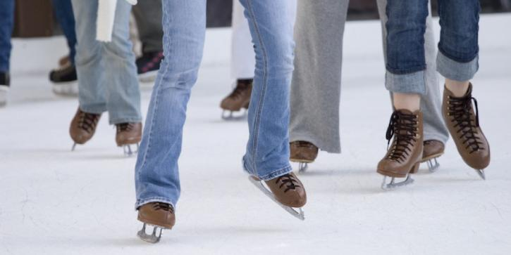 People ice skating at a rink