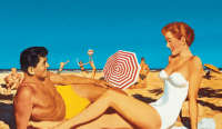 Man and woman on beach in vintage image