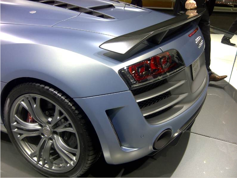 Plastic carbon composite spoiler on the back of Audi R8 GT.