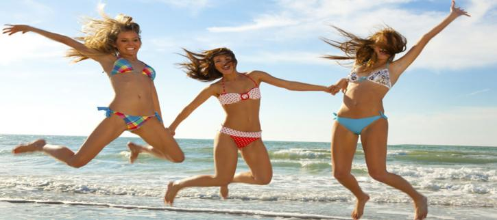 Three girls jumping on the beach