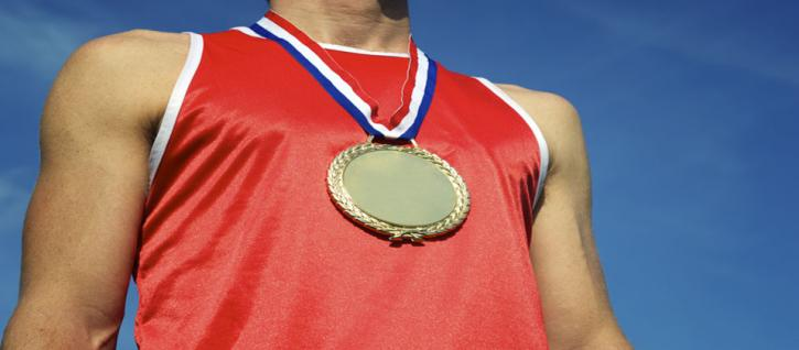 Gold medal around neck