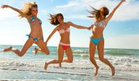 Three women having fun at beach