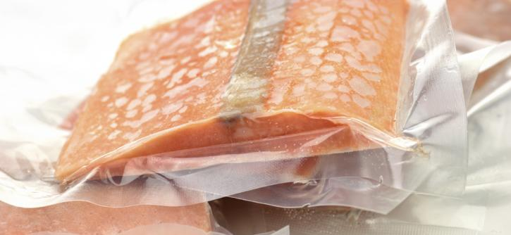 Frozen salmon in sealed plastic wrap