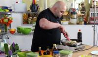Duff Goldman cooking with plastic kitchen tools
