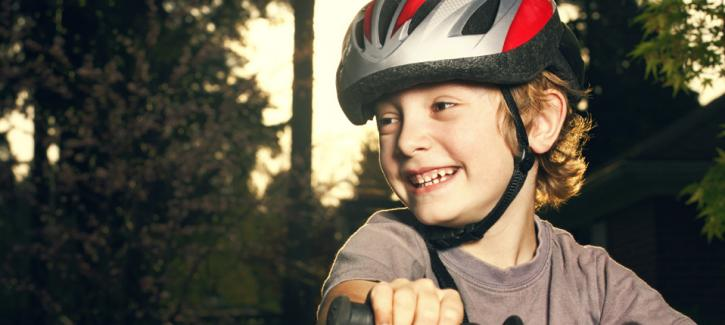 Young boy on bike wearing a helmet