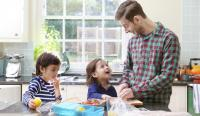 Dad making lunch and snacks in the kitchen with kids
