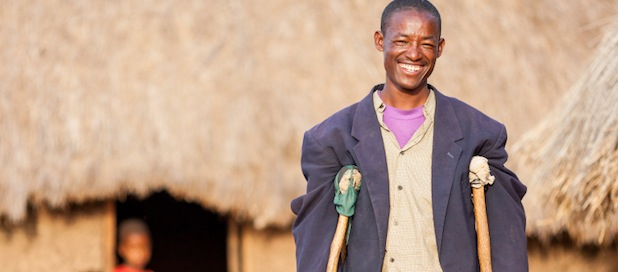 Smiling African man on crutches
