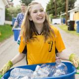 Young girls recycling on Earth Day