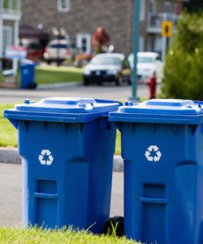Two blue recycling bins