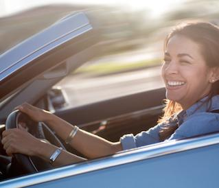Women smiling and driving