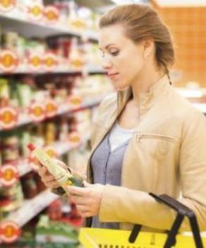 Woman holding food in grocery store aisle