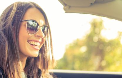 Woman wearing sunglasses driving