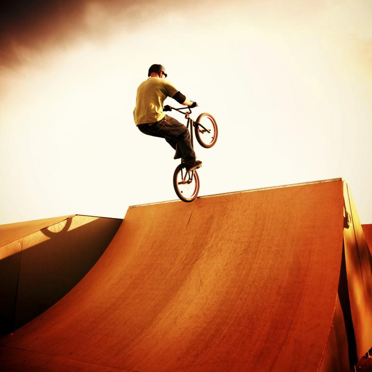 BMX bike artist jump on sport ramp