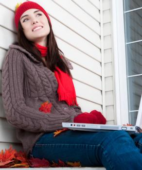 Woman outside with laptop.