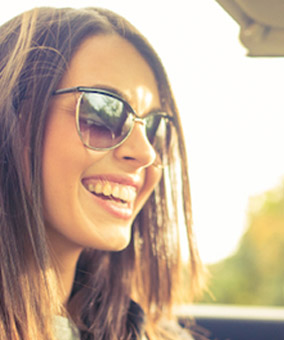 Woman smiling with sunglasses on