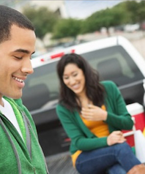 A man and woman tailgating
