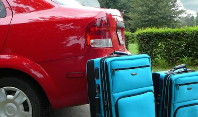Luggage next to car