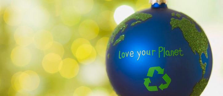 Christmas ornament of the earth with a recycle symbol