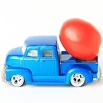Tomato on blue toy truck