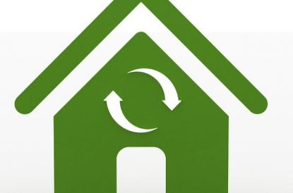 Illustration of green house with recycling symbol