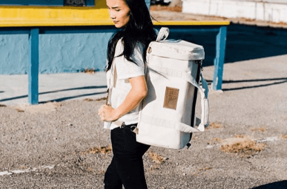 Girl carrying a duffel bag made with plastic