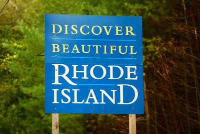 Welcome to Rhode Island sign at the Connecticut state line west of Providence, Rhode Island along state route 101.