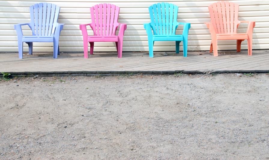 Multi-colored plastic lawn chairs