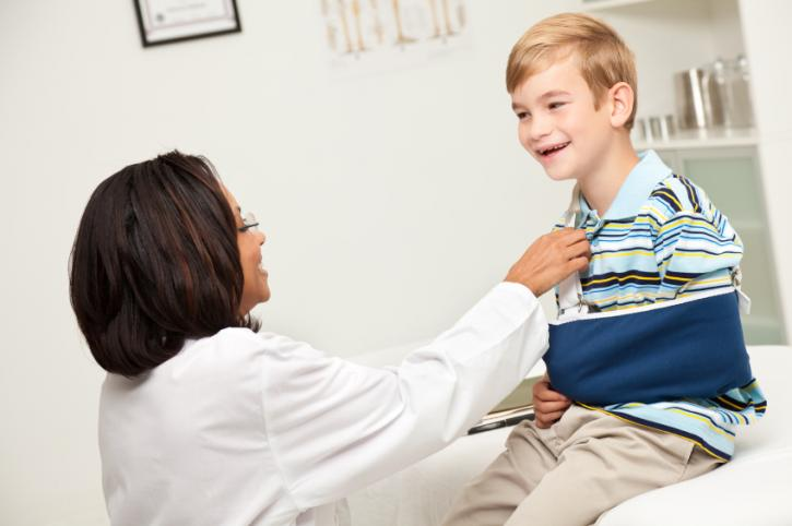 Female nurse with a young boy patient