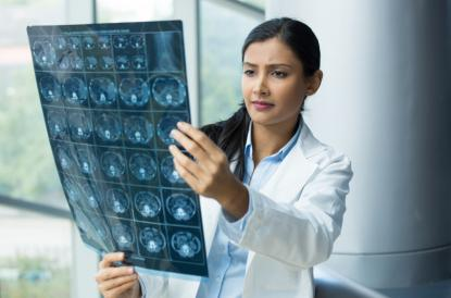 Female healthcare personnel looking at x-ray images