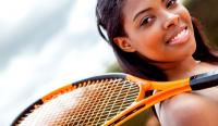 Female tennis player holding racket at the court