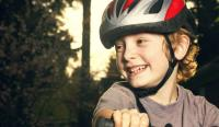 Boy in a bike helmet