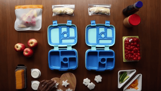School lunches and plastic lunch boxes being prepared