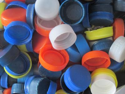 colored plastic bottle caps, all mixed together