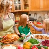 Mother and daughters cooking in kitchen