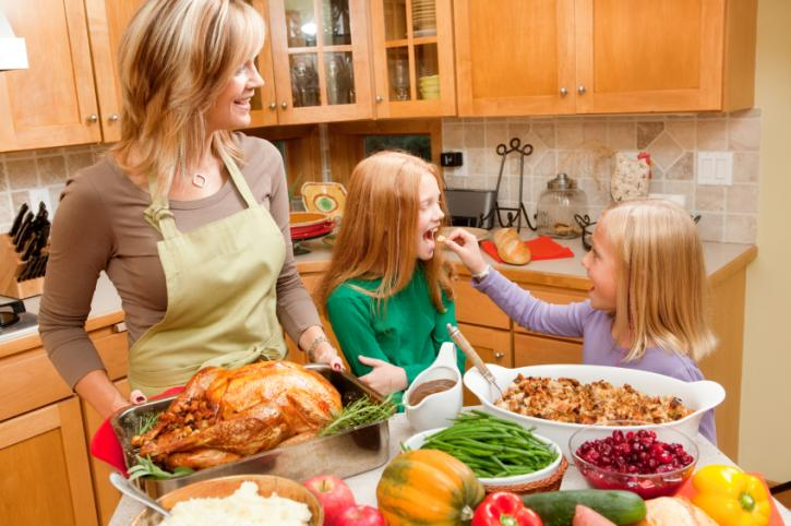 Mother And Daughters Cooking In Kitchen Plastics Make It Possible