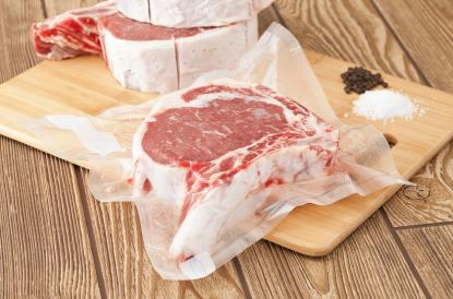 Vacuum sealed steak in plastic packaging