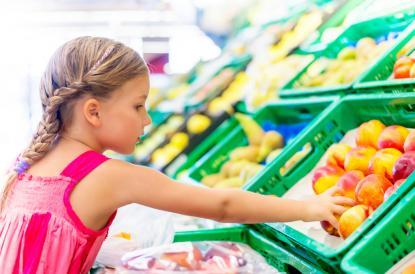 Girl grabbing healthy fruit and foods plastic packaging