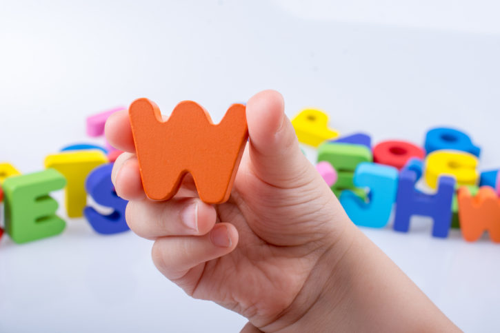Manipulatives like magnetic plastic letters and numbers are a good option for allowing kids to redirect extra energy.