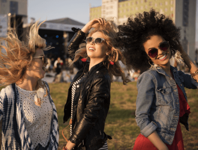 GettyImages - 538879480 - Girls Dancing At Outdoor Music Festival CROP